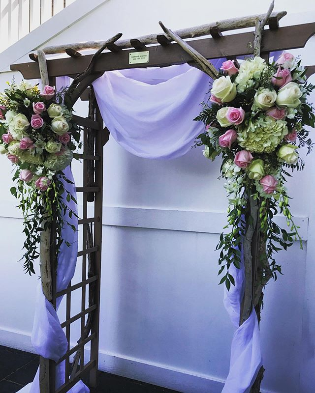 Handmade by the groom's father. #ceremony #woodenarbor #freshflorals #draperdecor #weddingseason2019 @ipswitchcountryclub