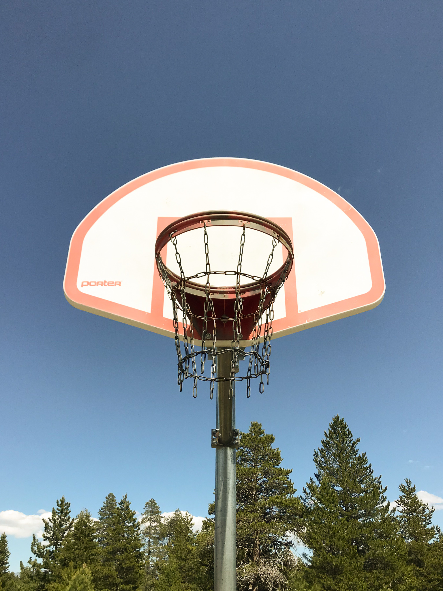 Metal net basketball rim in the forest