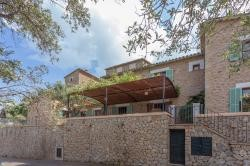 Ca'n Llimoner, Mallorca - Set amongst the picture postcard town of Deia with it's stone built houses and terracotta roofs. The Ca'n Llimoner villa lies facing the panorama of cliff-faced olive groves, rolling Mediterranean mountains and the sea beyond.