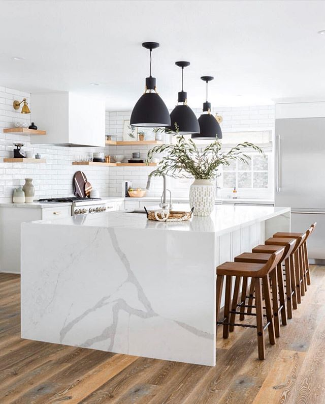 Functional, stylish and inviting. Great design work via @lindseybrookedesign #stylefile #dreamkitchen #interiordesign