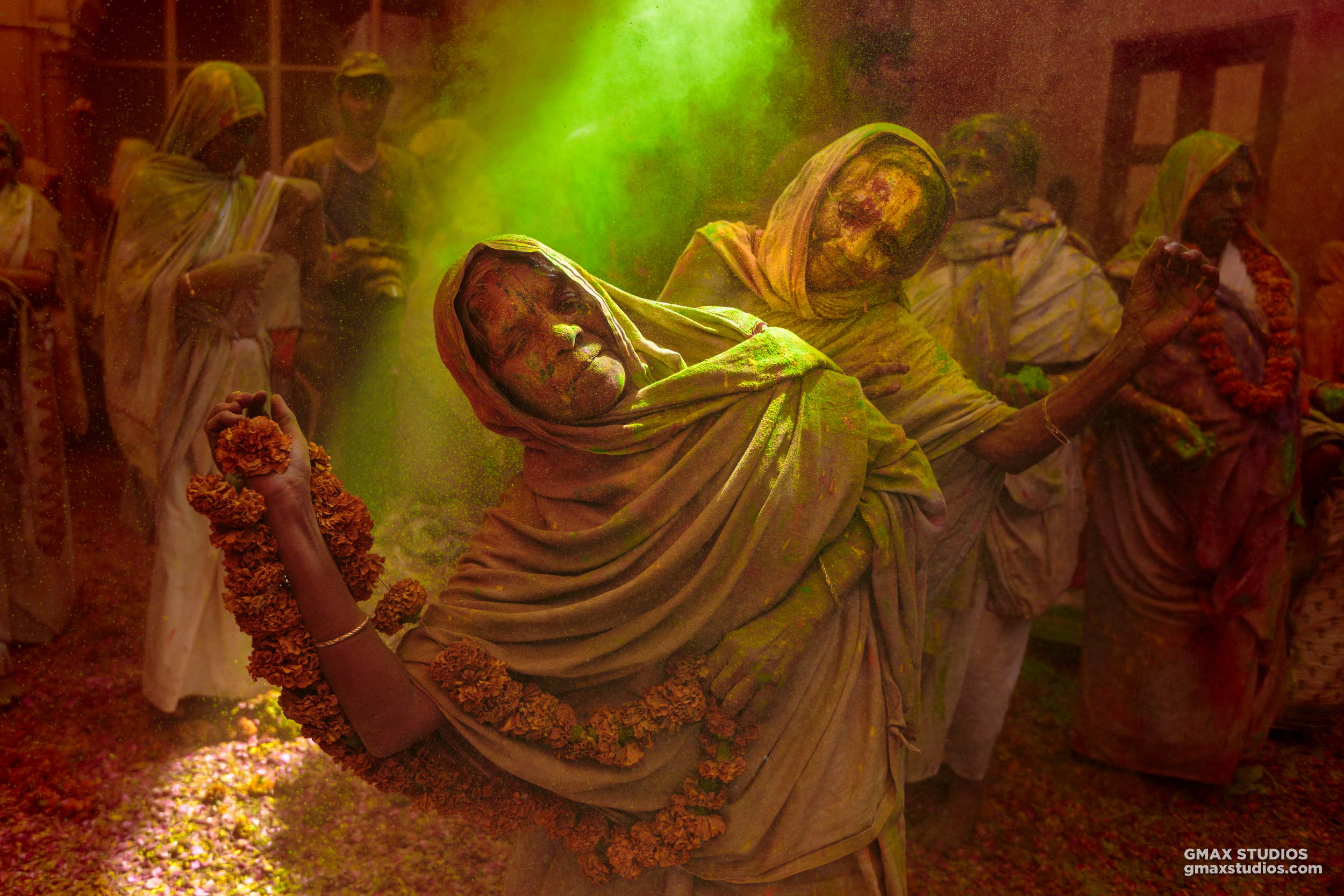 As a photographer, if you're determined enough, the opportunities present themselves. The tarpaulin roof in the temple corridor had a hole in it, and a trail of light shone through - making the moment even more magical.