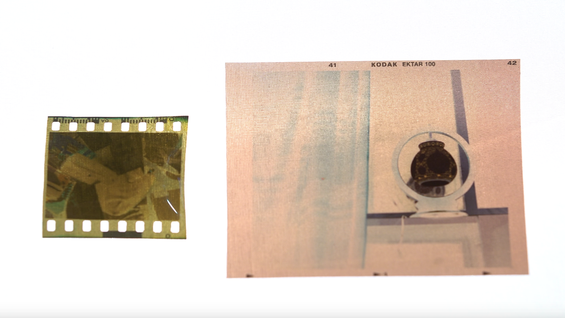 A standard 35mm film negative vs a medium format negative on the right. One can only imagine what it was like for photographers who had to carry such huge devices.