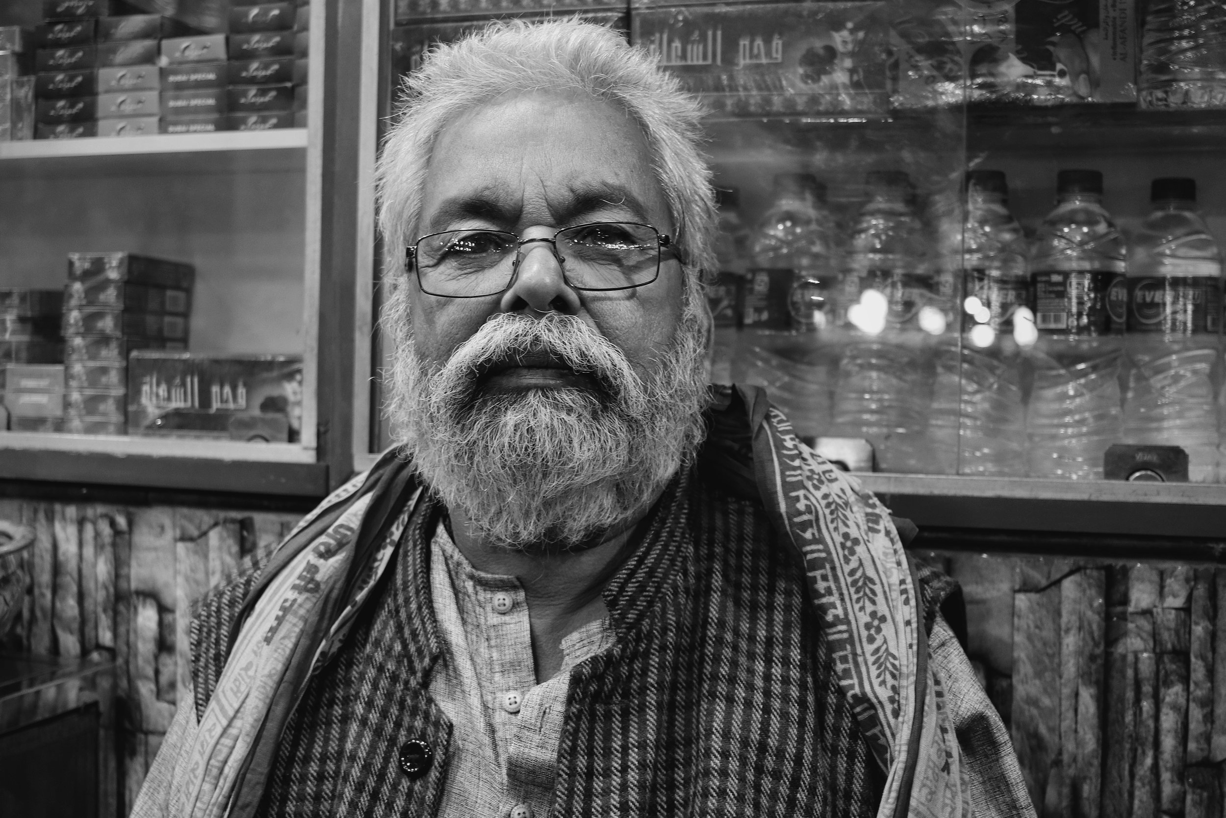 "One of the people I struck up a conversation with was this gentleman. He is the owner of a tobacco shop in Ghatkopar. We spoke for around fifteen minutes, talking about many different things. I complemented him on his look and he said, ""I wish you had met me earlier, the beard was much, much longer."""
