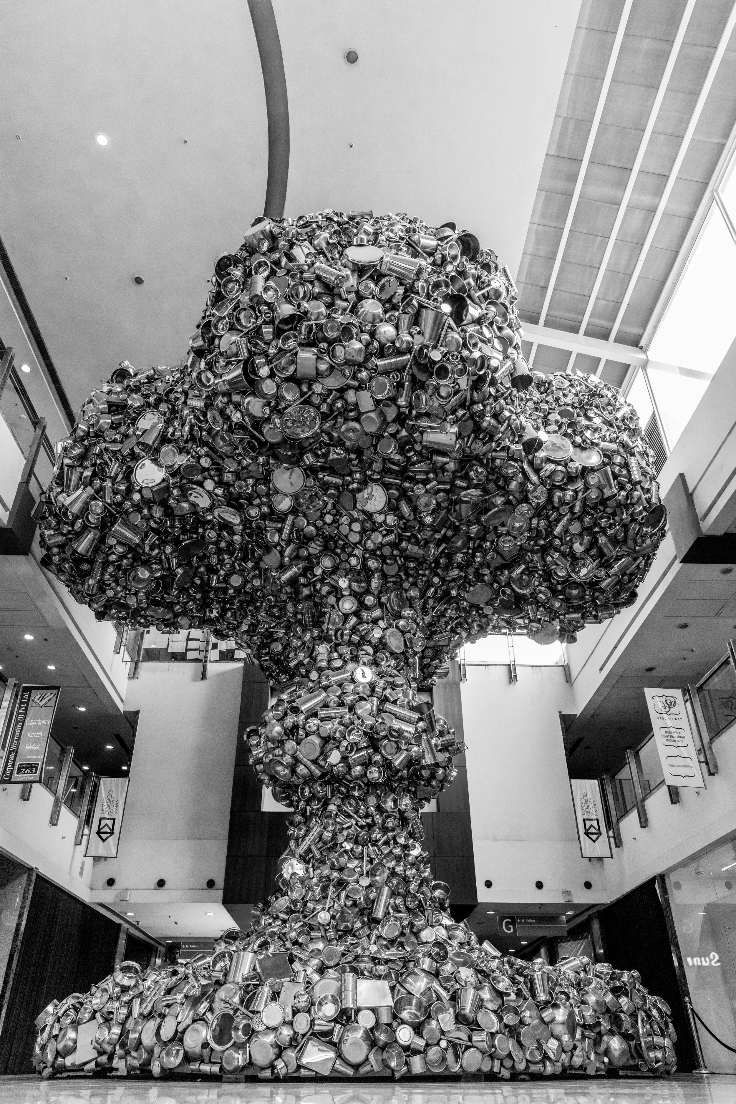 This is a huge mushroom-shaped Sculpture made from countless steel utensils. It is installed in  Kiran Nadar Museum of Art , Saket, New Delhi. It measures 36 X 36 ft and weighs 20 tonnes.