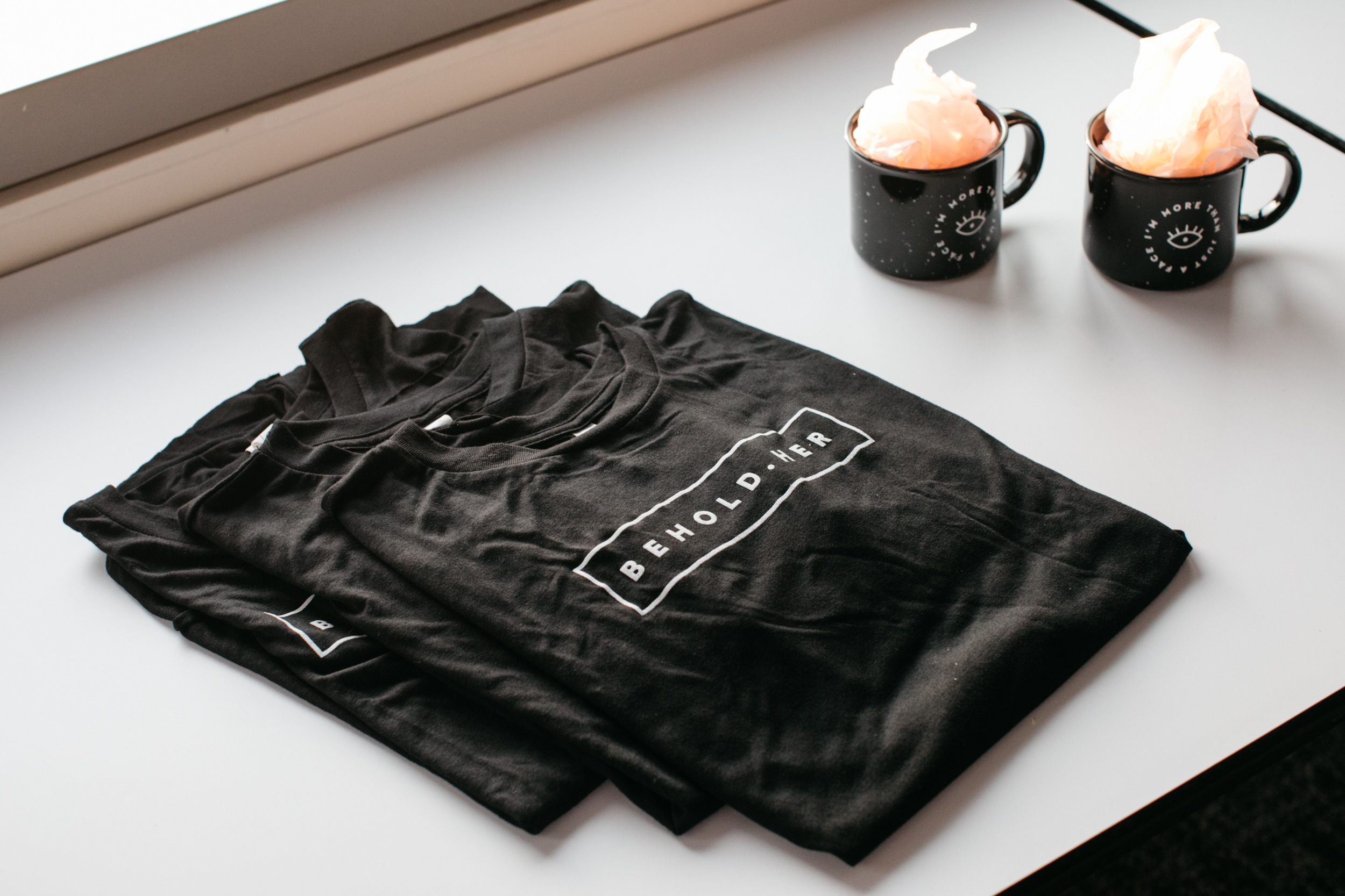 Limited edition tees and mugs that are sold exclusively at events.