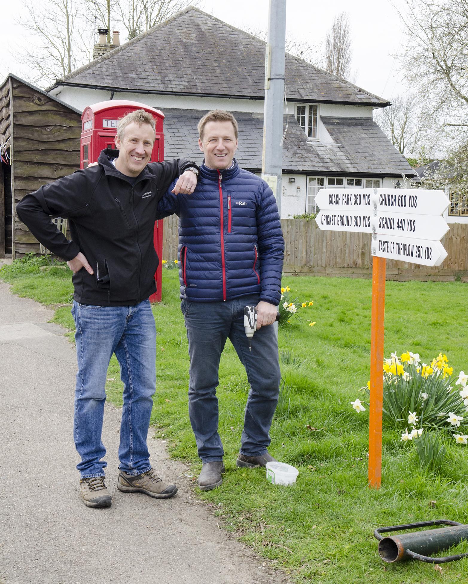 Jonny and Mark set up the signage