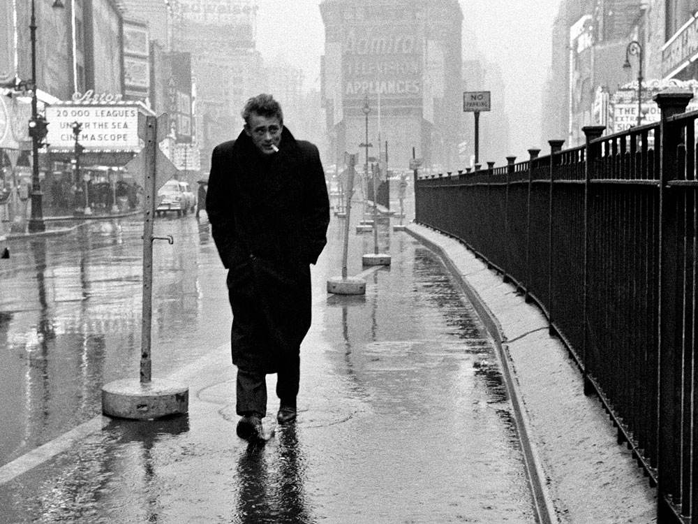 James Dean walks through a rainy Times Square -  Dennis Stock/Magnum Photos