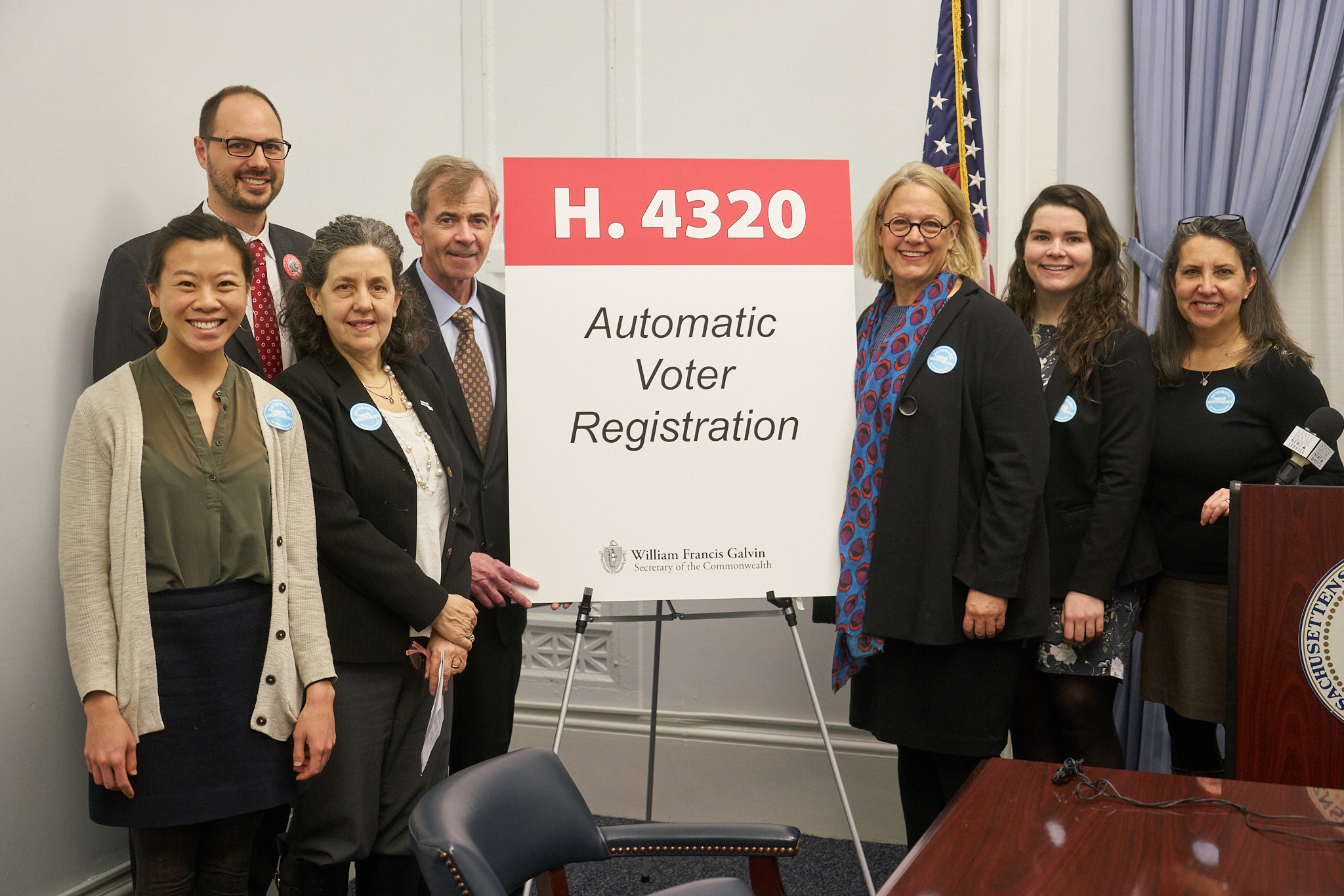 Secretary of State William F. Galvin with LEV founder Joyce Hackett (right of the sign) and members of the Election Modernization Coalition.