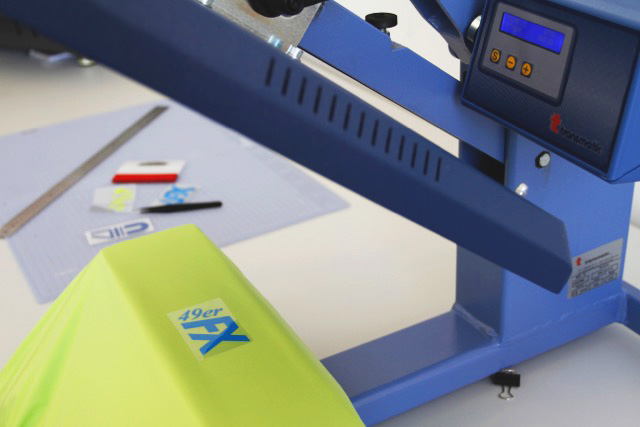 Process of pressing transfers into garment