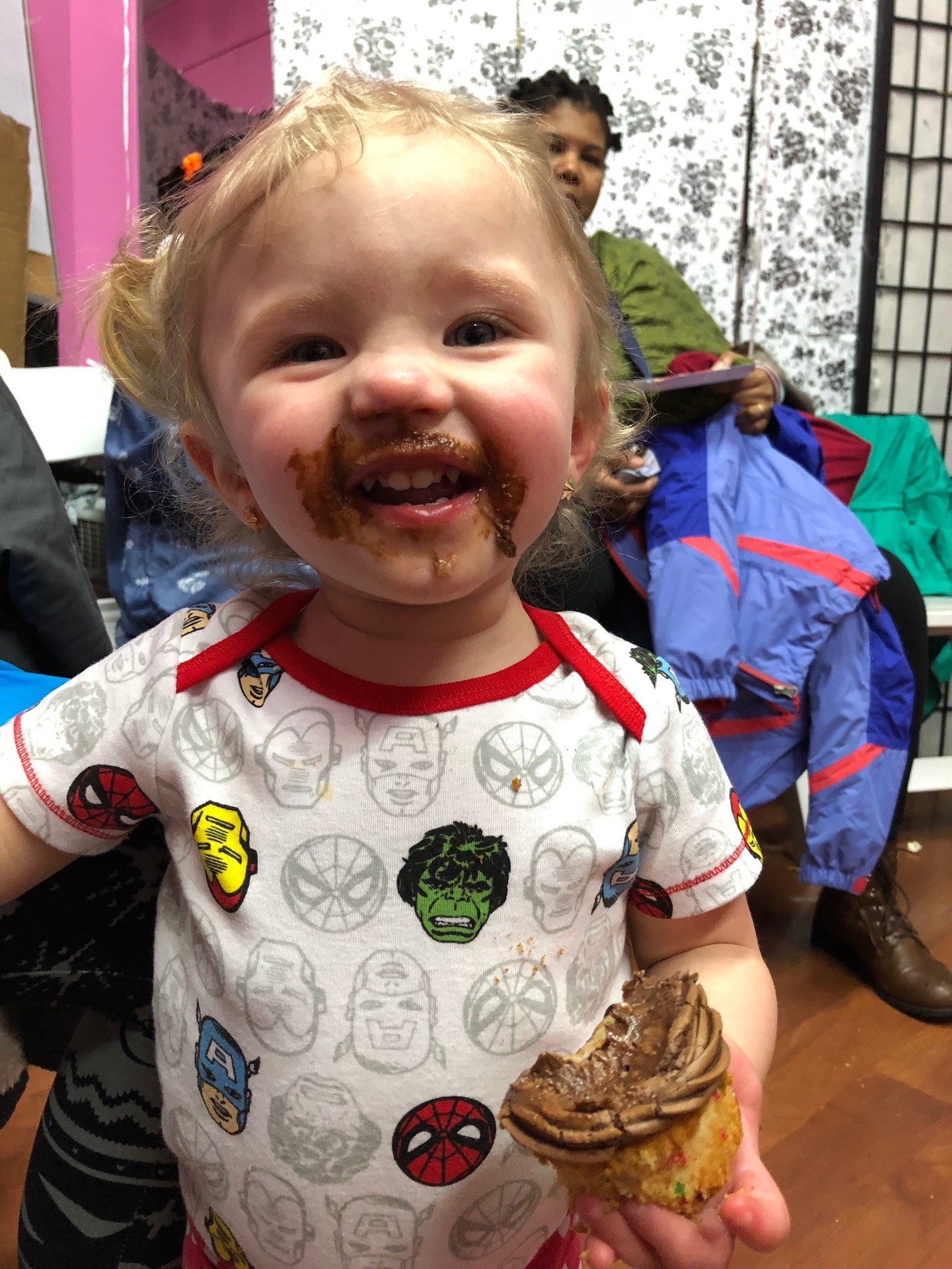 Hailey eating an Avengers Cupcake from Flour Love Sweets