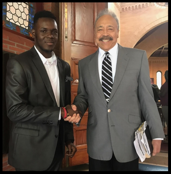 Trevor with William R. Harvey, President of Hampton University
