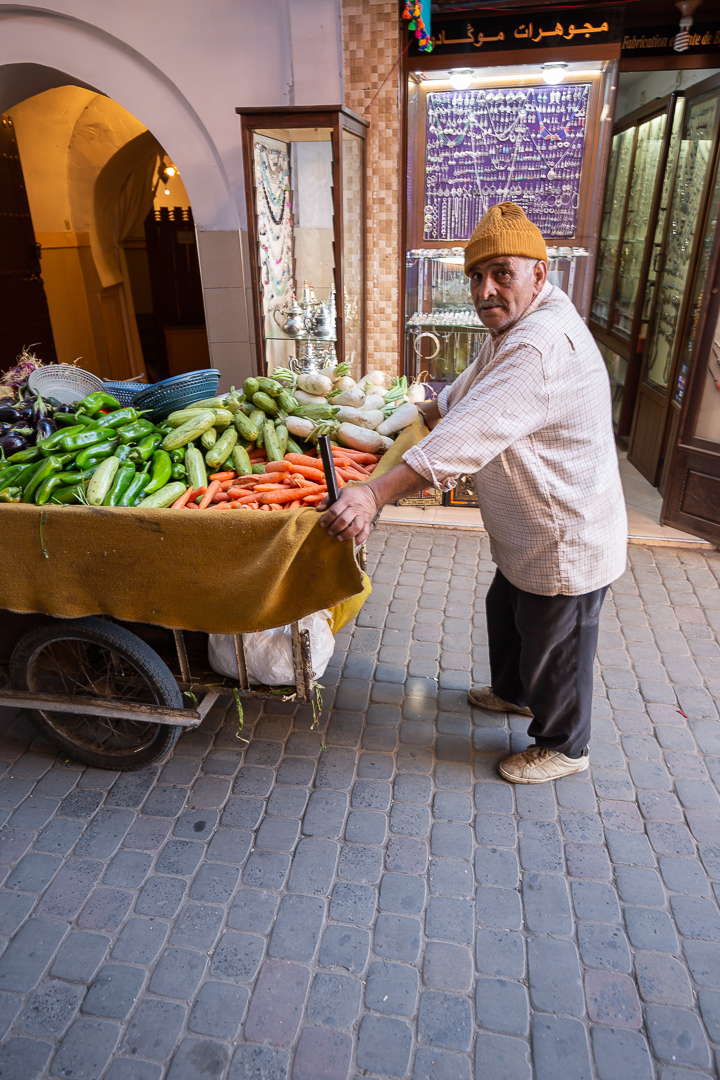 People here survive thanks to what they produce. In fact, the markets – or souks - of Marrakech are divided into product areas: vegetables and fruits, fabrics, ornaments, leathers and spices. The day begins very early in the Medina, and here a man transports his vegetables to the stand where he will spend the day selling them.