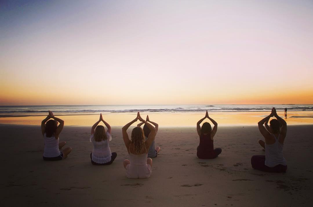 sunset yoga on beach.jpg