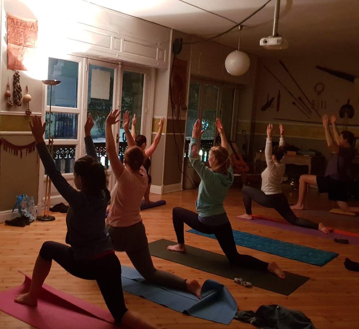 A community yoga class offered by a refugee that is a certified yoga & dance instructor.