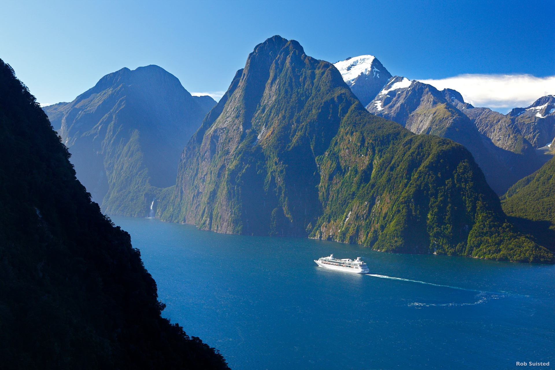 A scenic boat cruise in Milford Sound, surrounded by the towering peaks that enclose the Fiord is an absolute must!