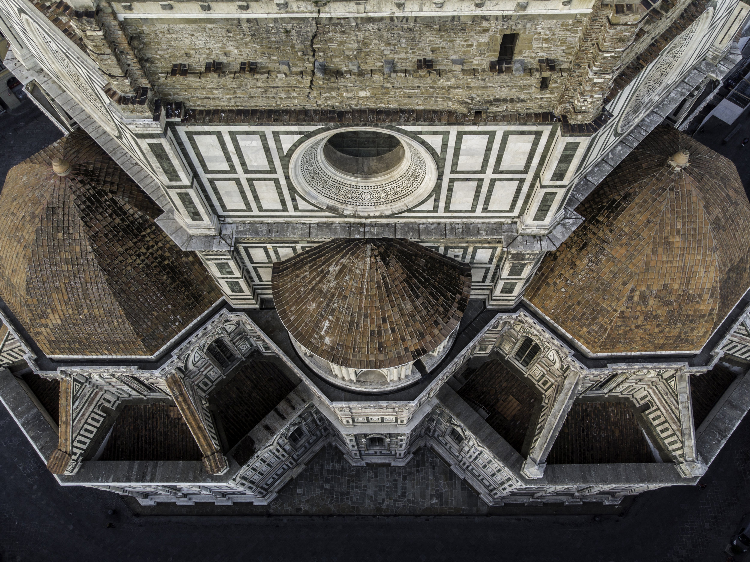 The exterior of the Duomo sources its marble from three locations: Carrara (white), Prato (green), and Siena (red), as well as others. It boasts a footprint of 8,300 m2 (89,0002 ft.) and is a UNESCO world heritage site. Photo credit: Freethedust