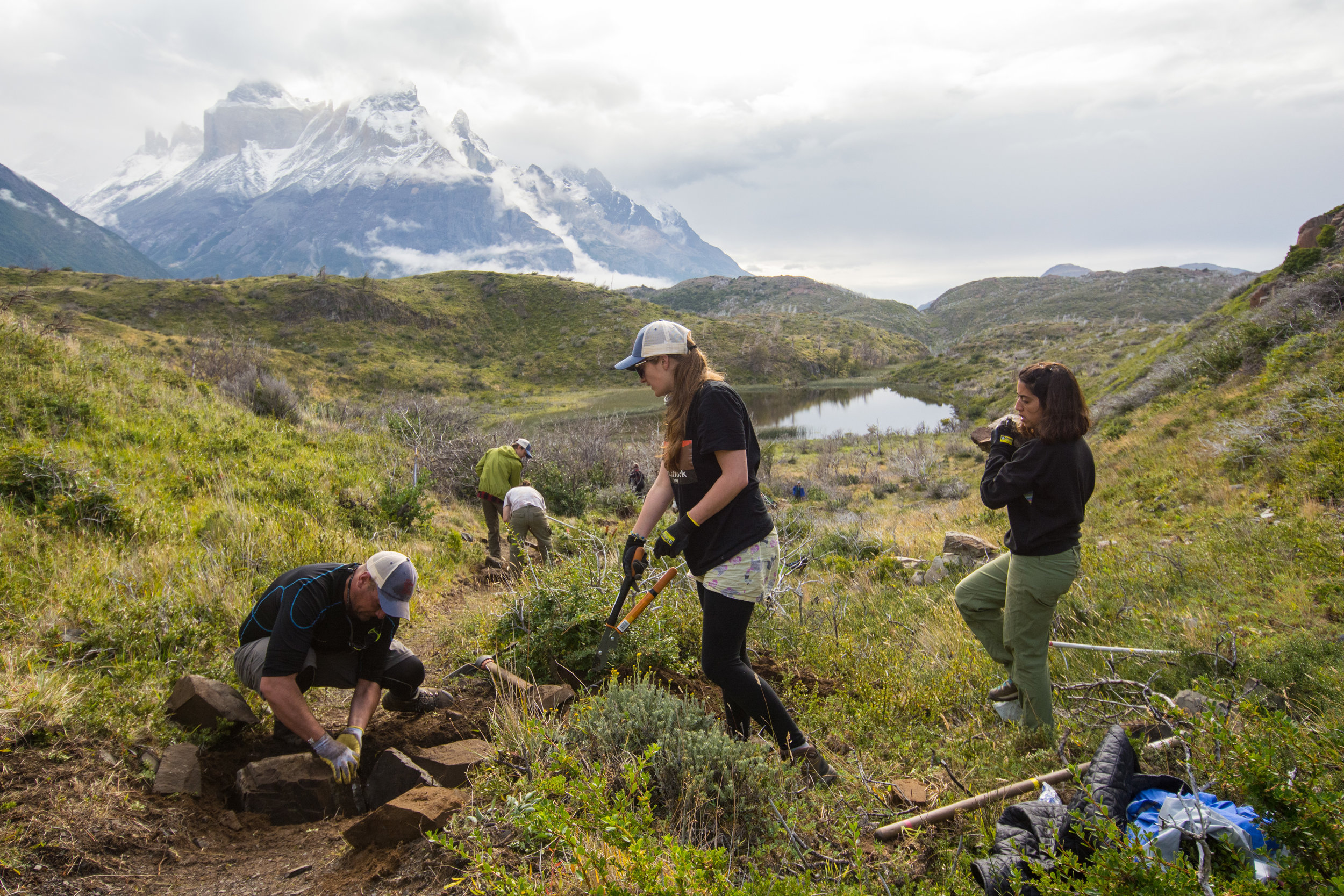 Legacy Fund volunteers construct water bars on a new trail to control erosion. Photo: Timothy Dhalleine