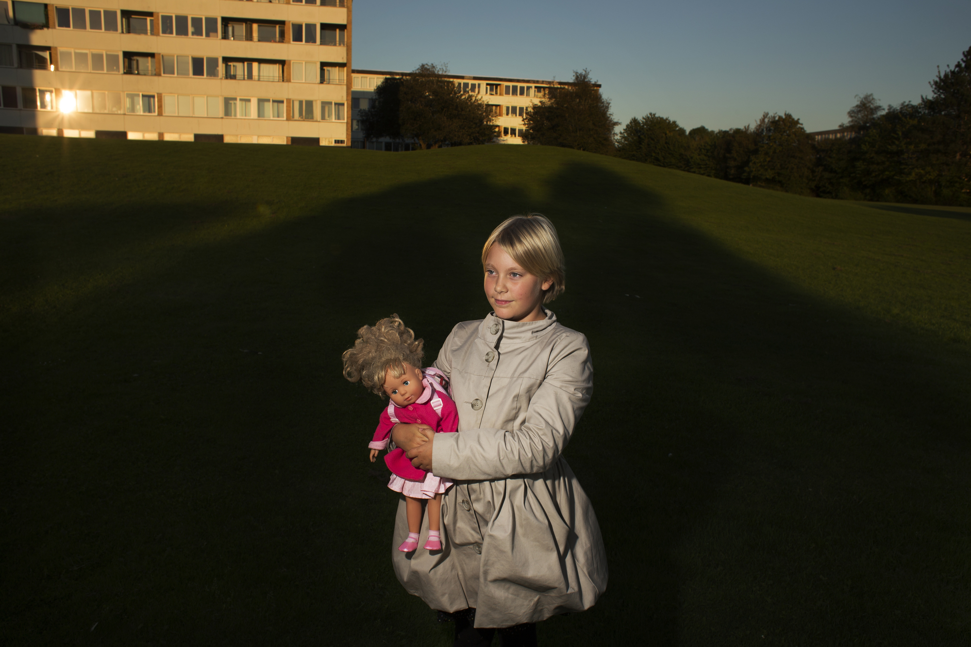 Martha Holt Johansen, 9, of Aarhus, Denmark, holds her doll outside of her apartment complex where she lives with her mother.