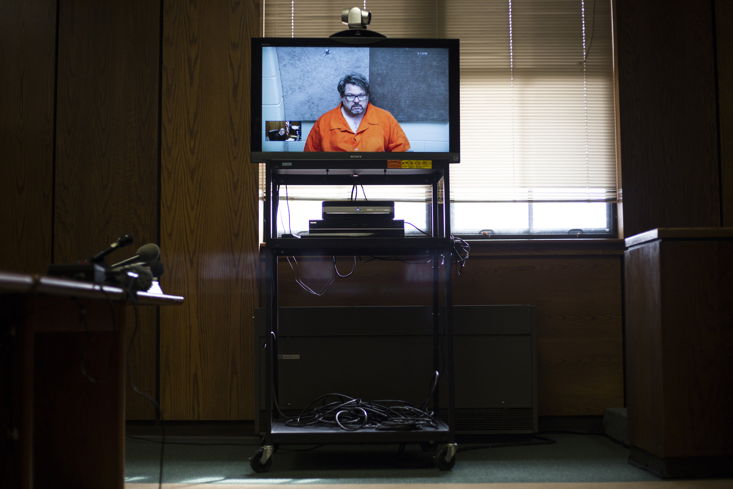 Suspected shooter Jason Dalton appears on a television screen for a video conference during his arraignment at the 8th District Court in Kalamazoo, Mich., on February 22, 2016. Dalton was suspected of killing six people and injuring two in a shooting spree that occurred that Saturday evening.