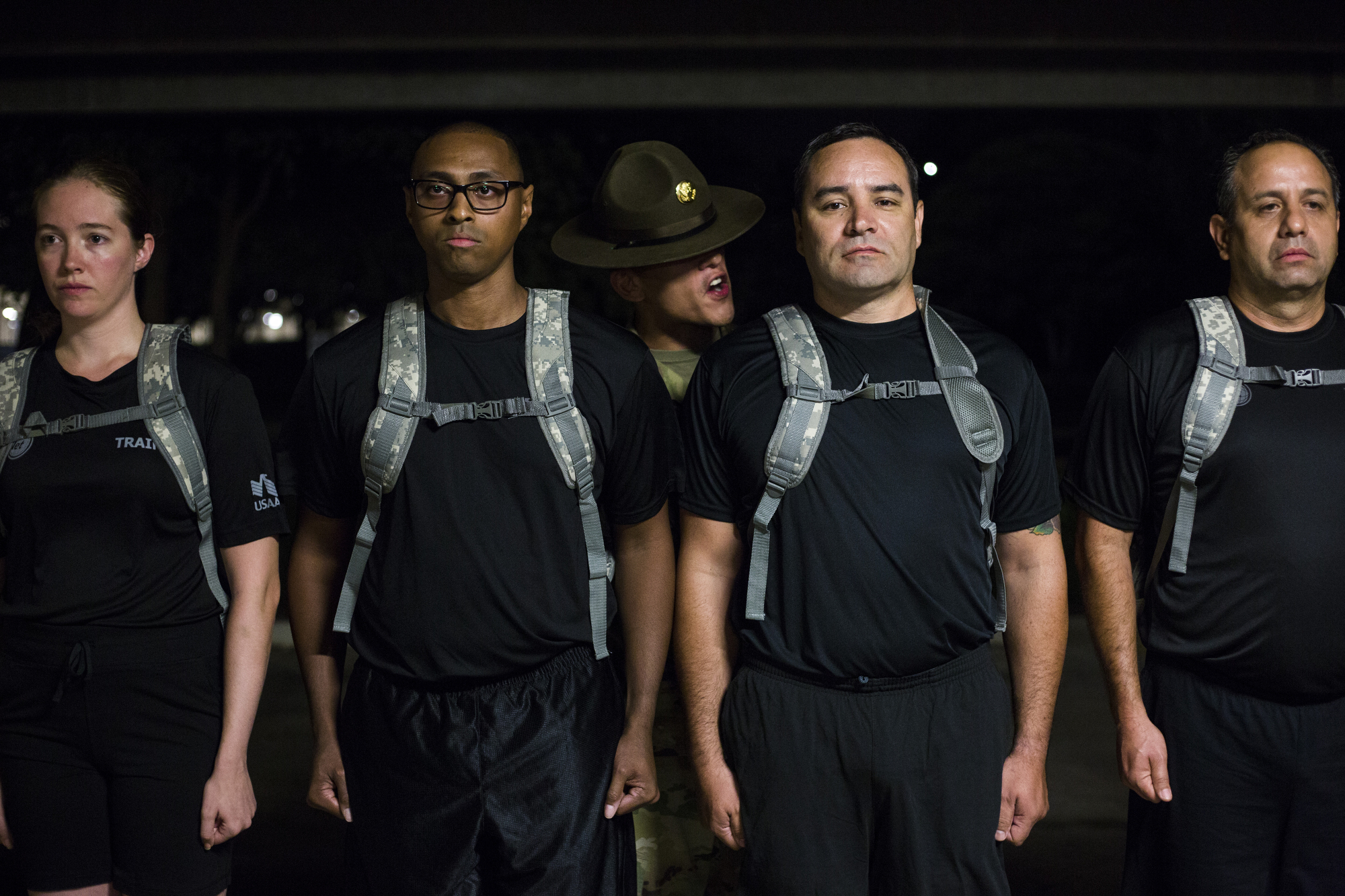 """A drill sergeant puts employees under a """"shark attack"""" simulation, in which military members are yelled at and put under mental pressure, during the USAA Zero Day PT held at USAA's San Antonio head quarters on Friday, July 15, 2016. The bootcamp invited 400 of USAA's employees for a simulation of what military members experience on their first day of basic training."""