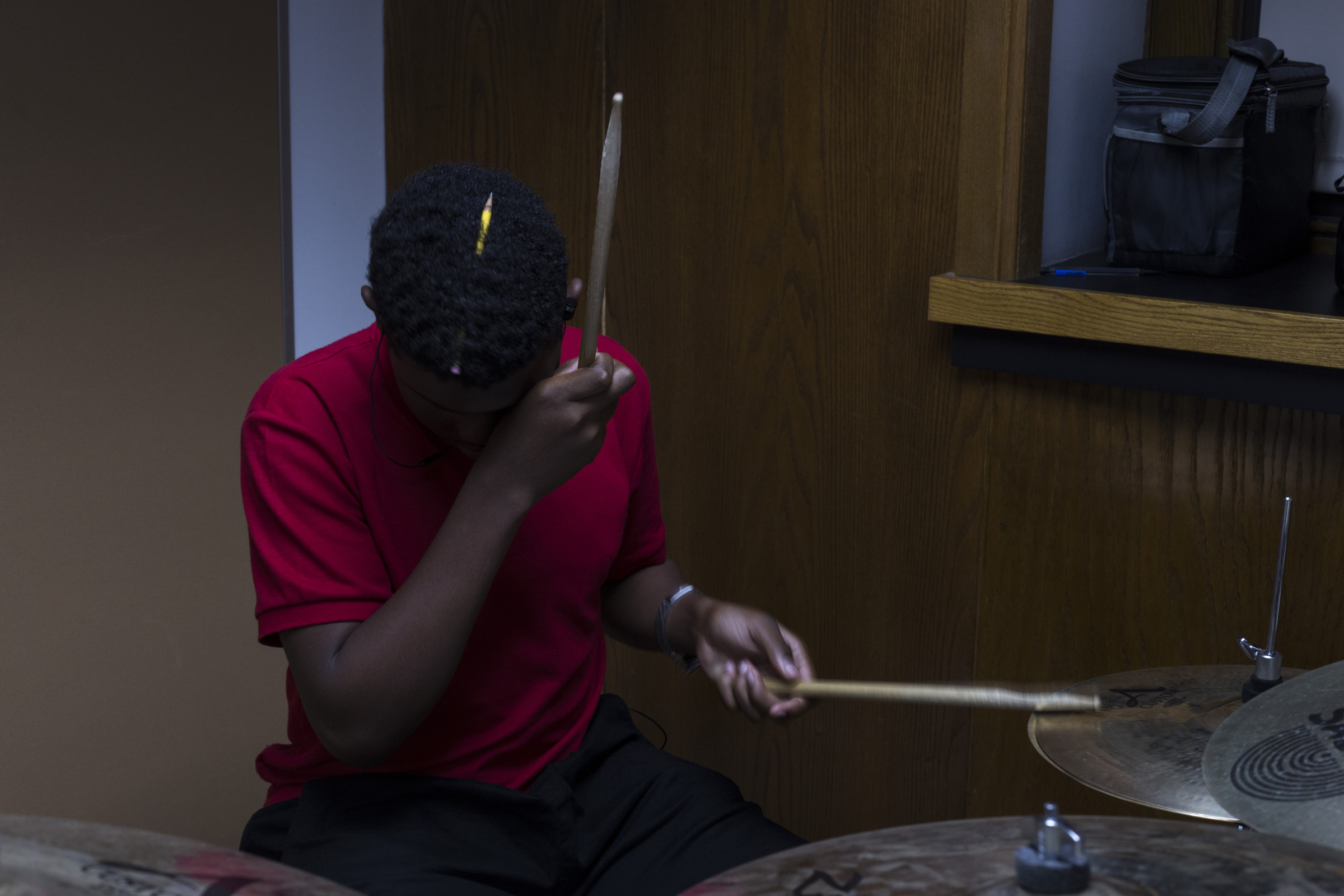 Holding a pencil in his hair, Christoph Gibbon, 16, plays the drums in sequence with his classmates during Jazz band at the High School of Commerce in Springfield, Mass., on Monday, September, 11, 2017.
