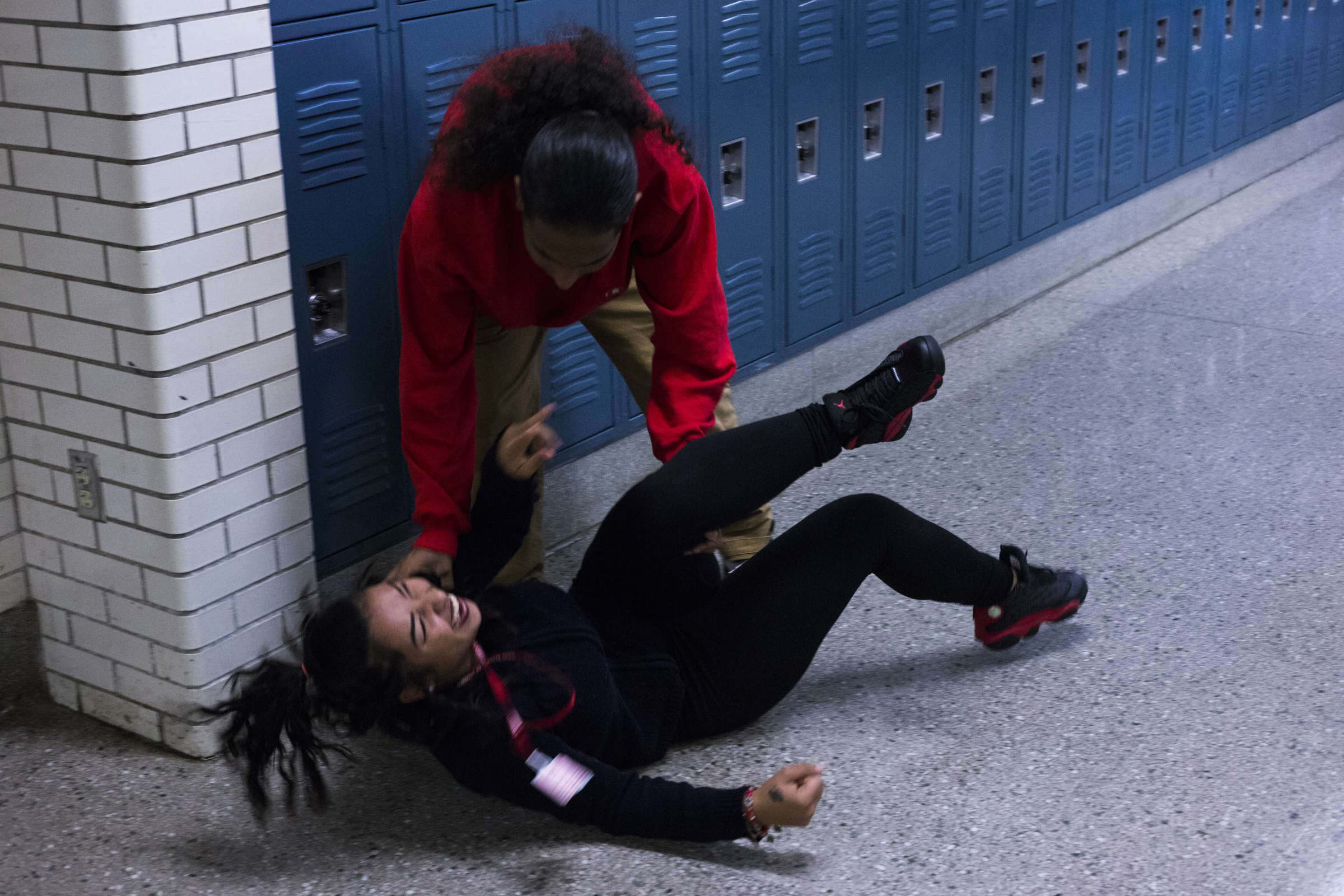 Anthony Castillo, 18, playfully swings around Greysey Gomez Ortiz, 18, in the hallway between their classes at the High School of Commerce in Springfield, Mass., on Monday, September, 11, 2017.