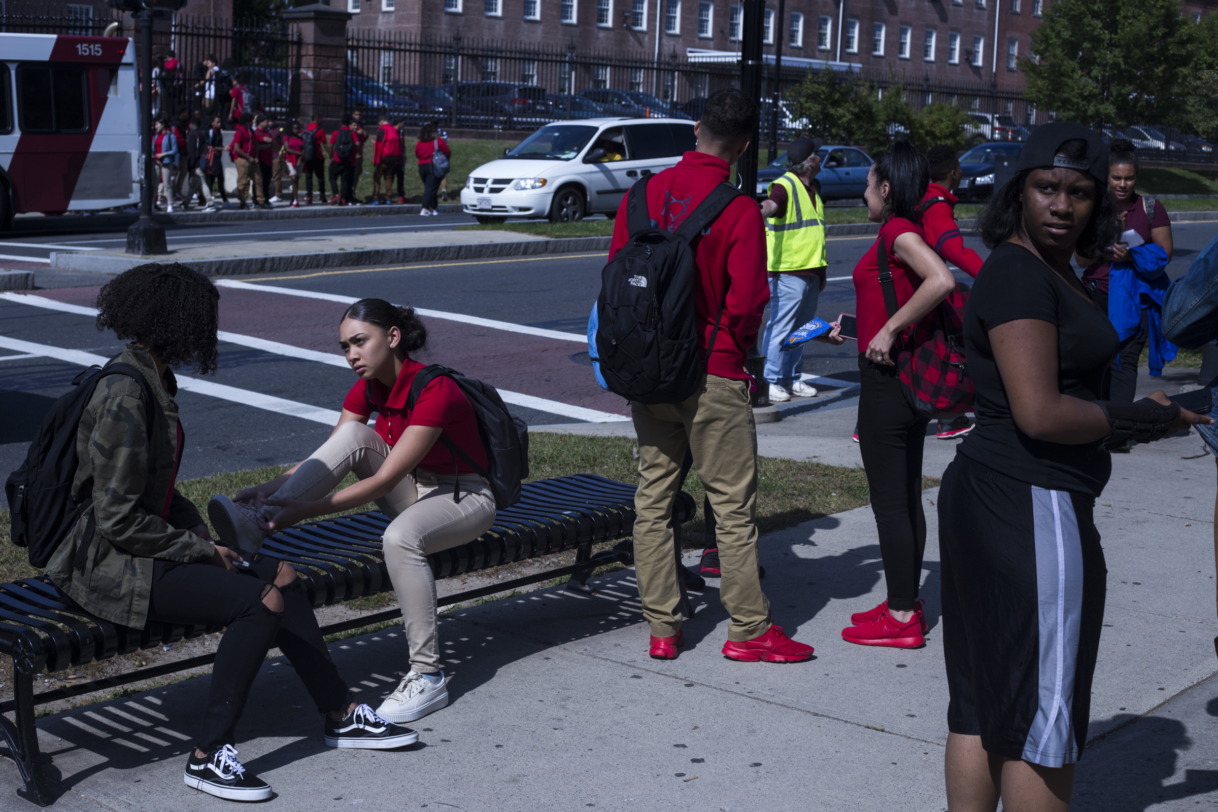 Students wait for transportation out front of the High School of Commerce following their school day in Springfield, Mass., on Monday, September, 11, 2017.