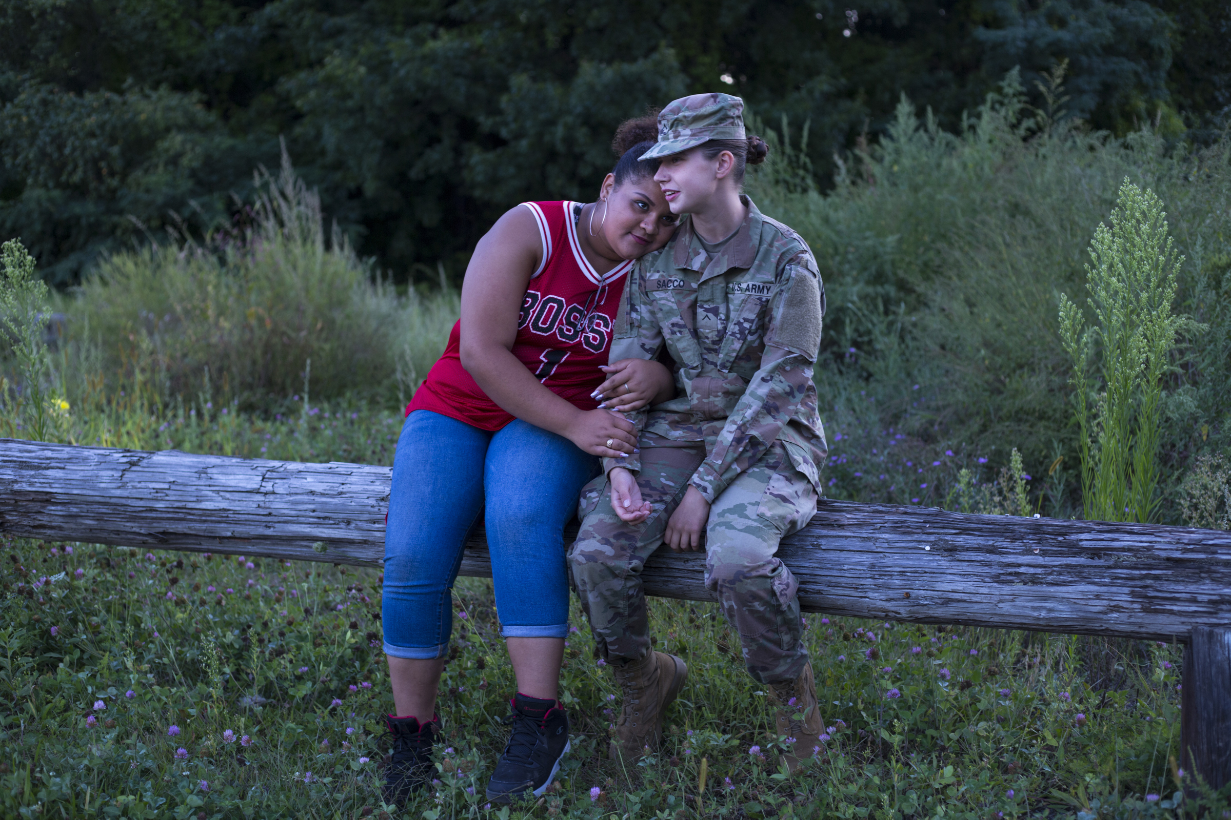 Destiny Montez, 17, with her girlfriend, Jenny Sacco, 17, at the Agawam Dog Park where they took Jenny's dog and hung out with friends in Agawam, Mass., on Saturday, September, 9, 2017. The pair have been together for two years and have hopes of moving in together following high school. When Destiny first came out to her mother she was disowned by her and has faced bullying at school for her sexuality.