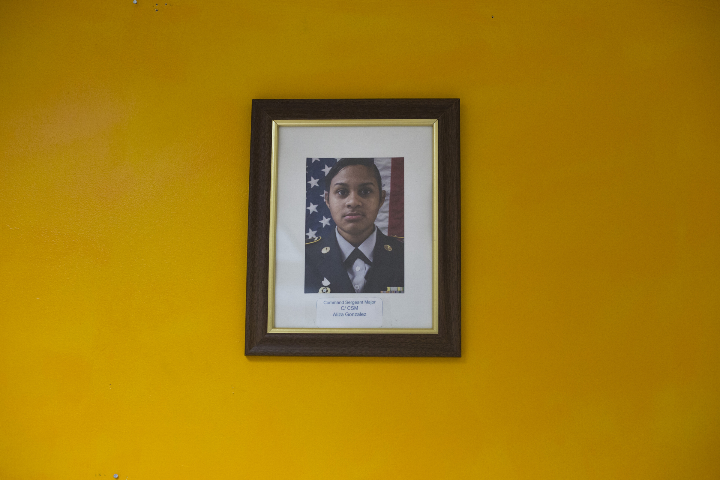A single photograph featuring Command Sergeant Major Aliza Gonzalez, 17, hangs on the wall in a JROTC classroom in Springfield, Mass., on Monday, September, 11, 2017.