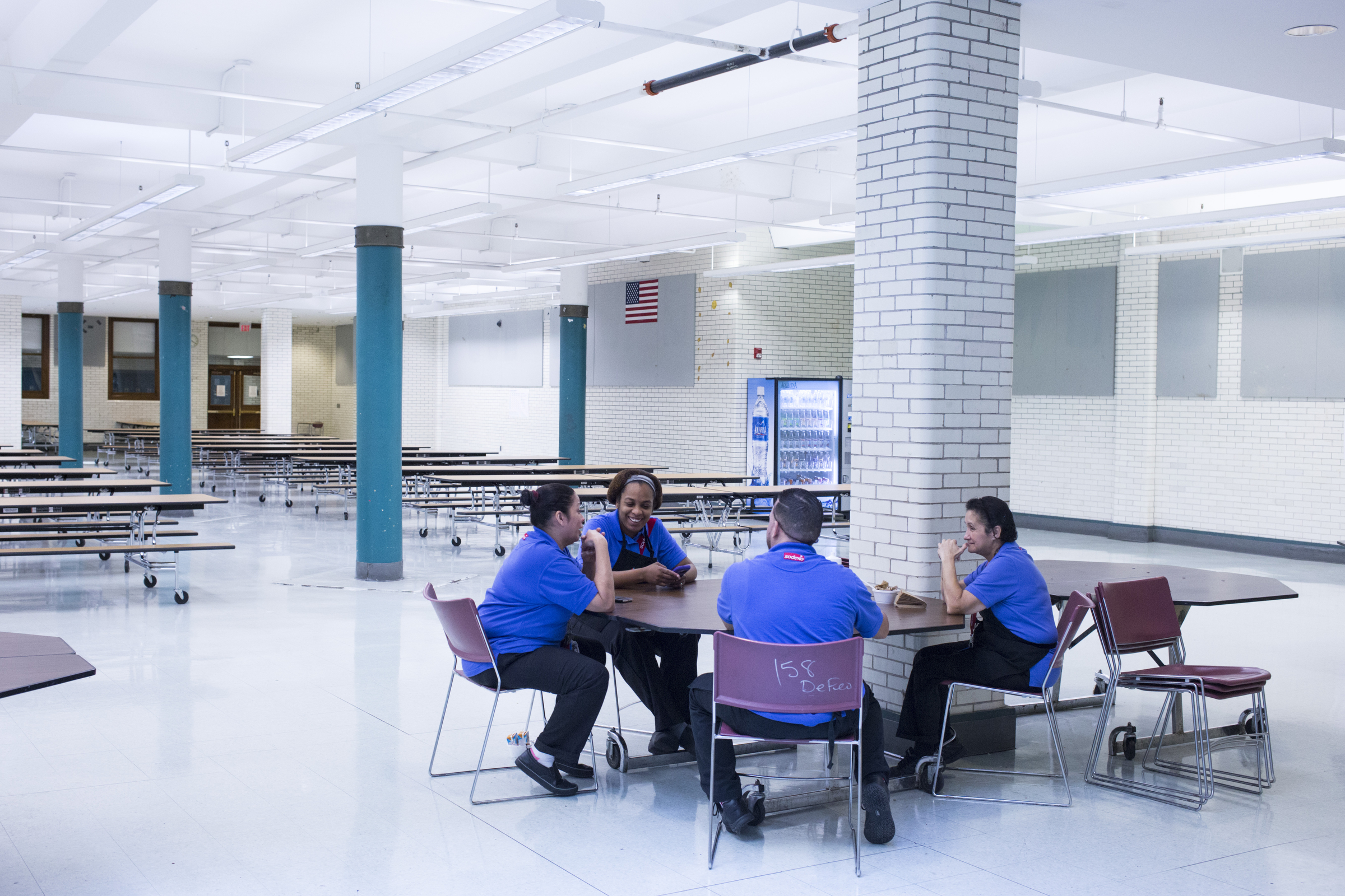 Selina Torres, center, talks with other cafeteria staff members during a break before lunch is served at the High School of Commerce in Springfield, Mass., on Monday, September, 11, 2017.