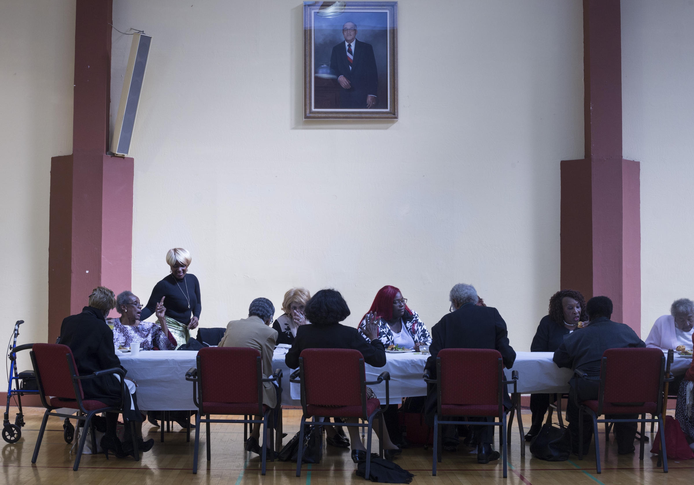 Members of the congregation sit for a luncheon following the service at the Third Street Baptist Church in the Fillmore, a quickly gentrifying district, of San Francisco, California., on Sunday, November 5, 2017.