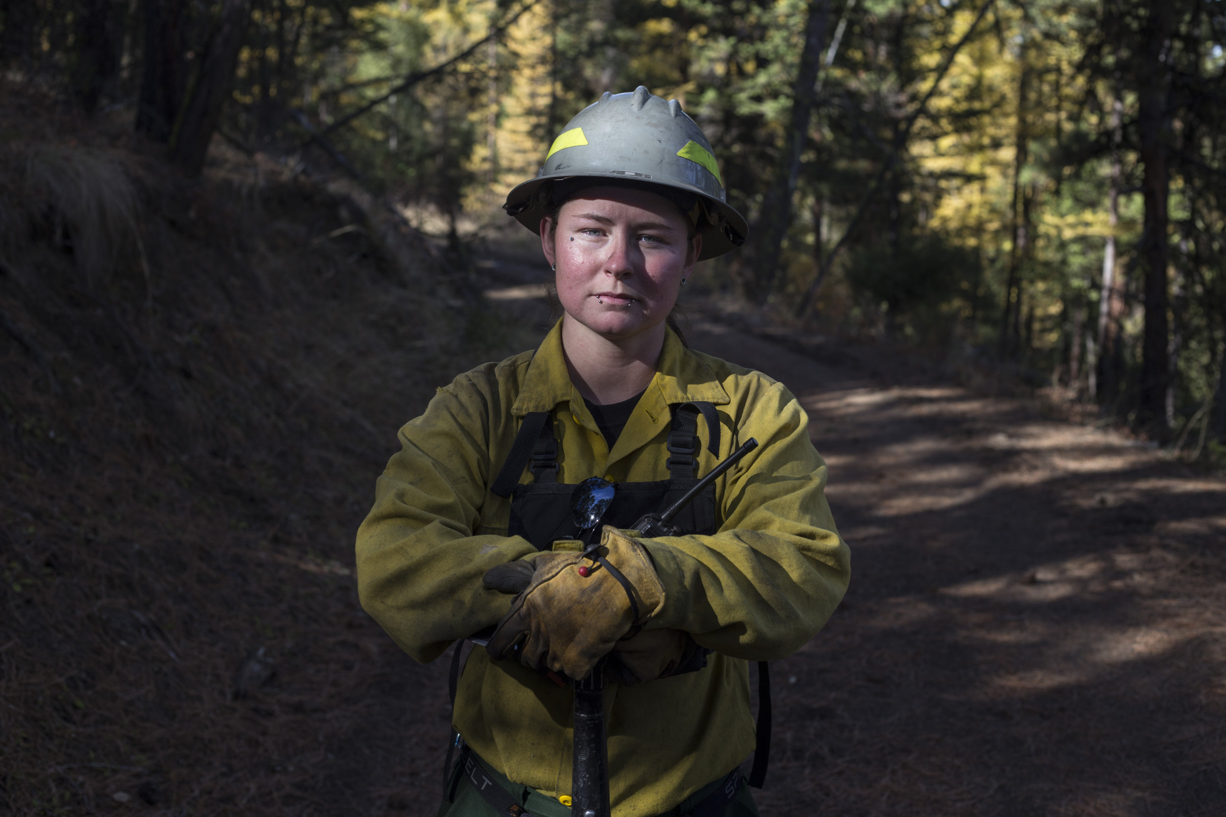 Lindsay Burland Roullier, 27, an enrolled member of the Confederated Salish and Kootenai Tribe, a forest technician and wild and fire fighter, at the site of a controlled burn she had been working outside of Elmo, Montana., on Tuesday, October 24, 2017. Roullier's father worked as a member of the CSKT Division of Fire for nearly 22 years when he was killed by a drunk driver coming home from work. She said she started the job as a way of honoring his legacy.