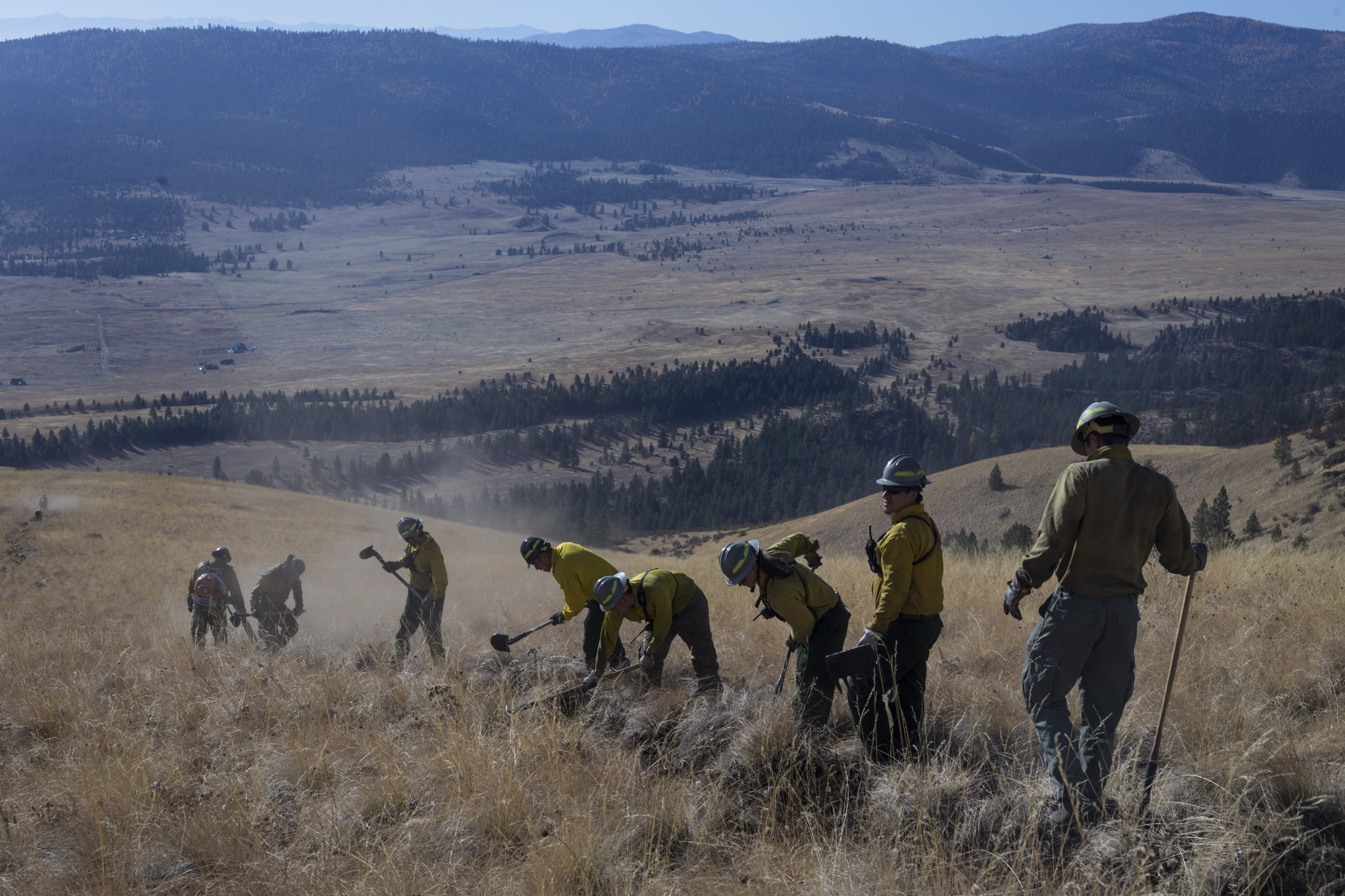 Members of the Confederated Salish and Kootenai Tribes Division of Fire prepare a barrier for a prescribed burn just along a ridge line outside of Elmo, Montana., on Tuesday, October 24, 2017.