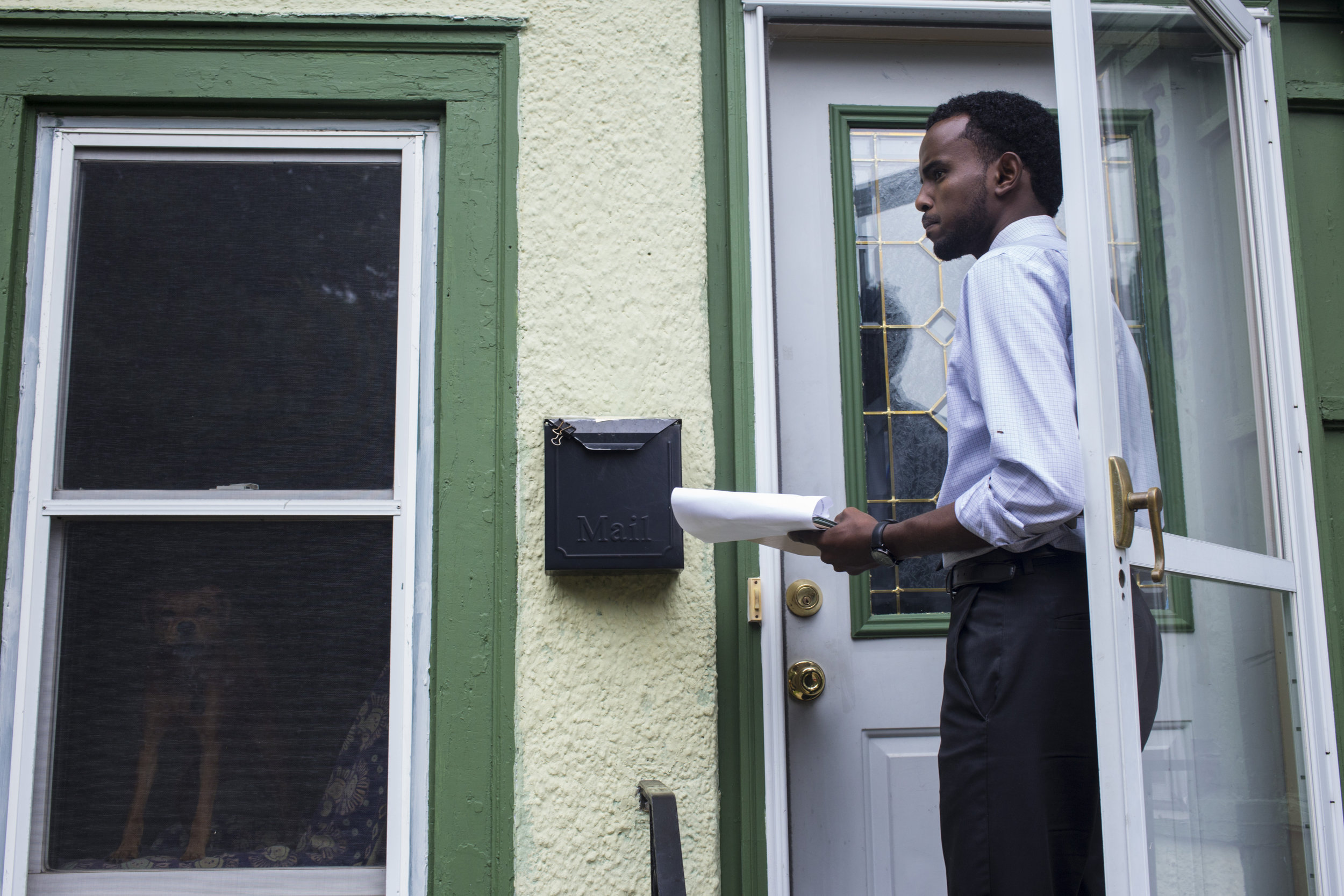 AK Hassan, 26, goes door to door to people's homes while campaigning for Minneapolis Park Board in, Longfellow, Minneapolis, Minn., on Saturday, October 7, 2017.Hassan was eventually elected becoming the first Somali and youngest person to ever serve on the park board.
