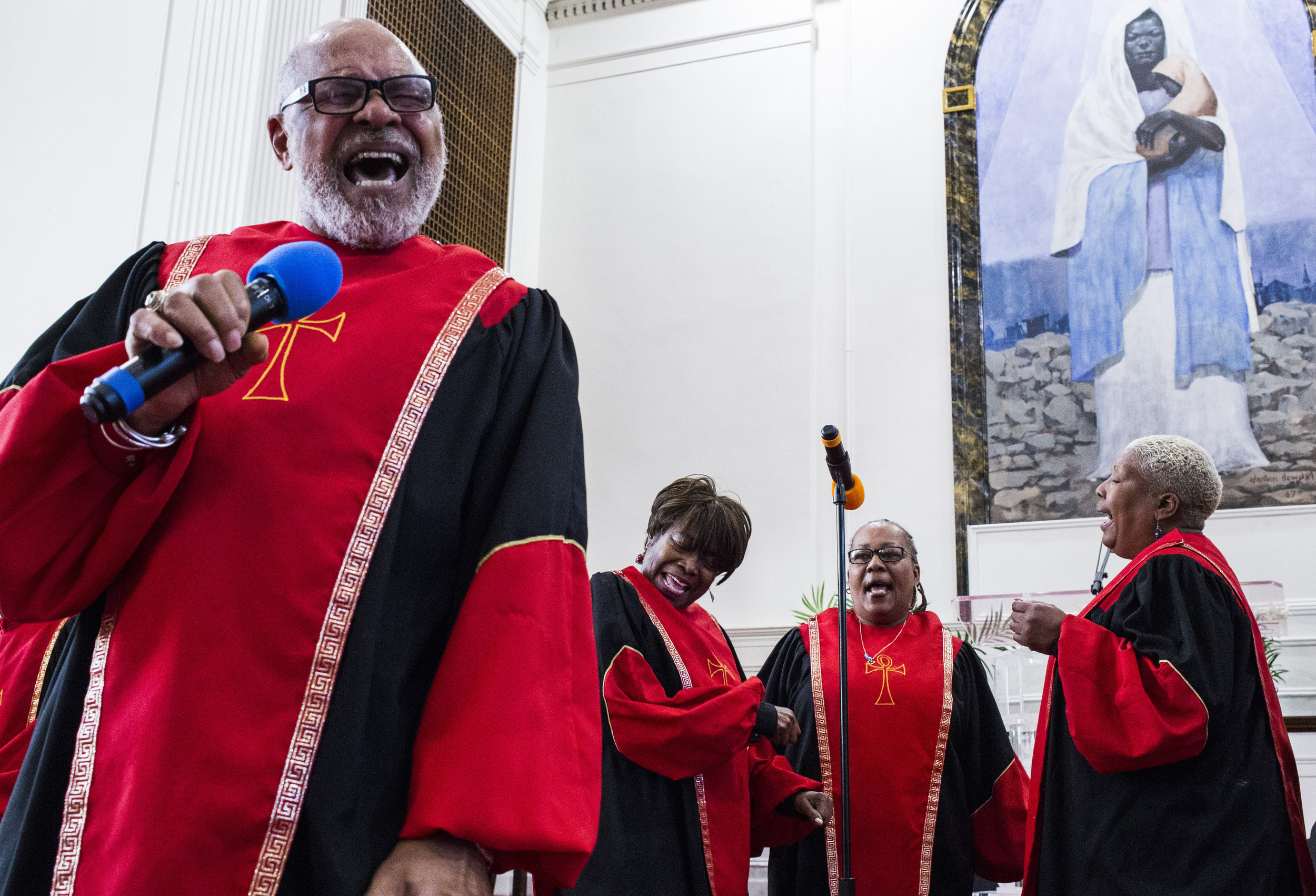 Ireji Flowers, of Detroit, leads the congregation in song during the morning service at the Shrine of the Black Madonna Pan-African Orthodox Christian Church in Detroit on Sunday, April 23, 2017. The church celebrated its 50th anniversary since the reveal of the Black Madonna painting in it's sanctuary.
