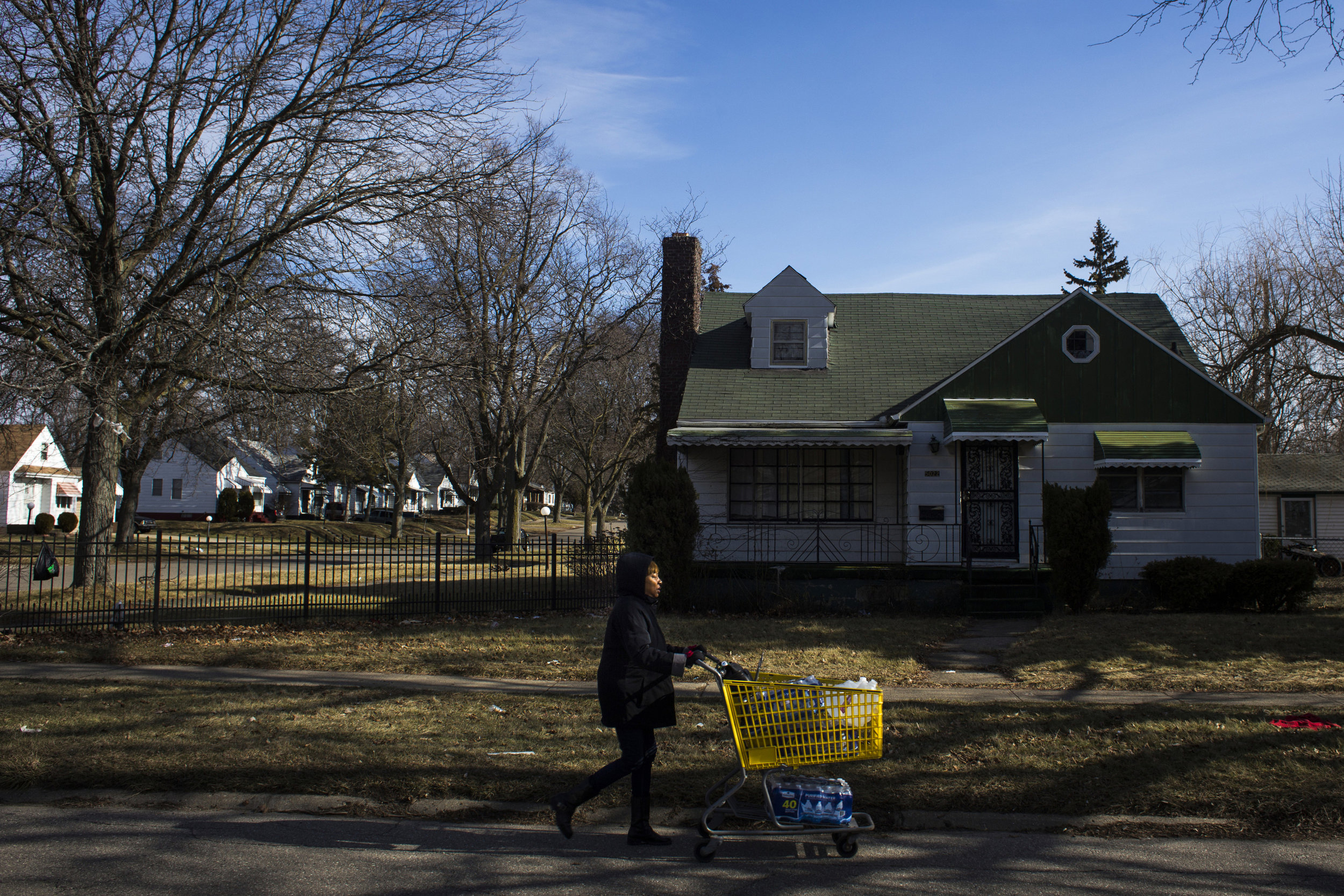 Brenda Briggs, a native of Flint, Mich., pushes a grocery cart full of bottled water to her home, which was several blocks away from a water drive put on by volunteers from Syracuse and Buffalo, New York, in the North side of Flint on Saturday, February 6, 2016. Briggs, a mother of three and grandmother to four, made the journey to nearby water resource centers every week despite arthritis pains and maintaining her diabetes.