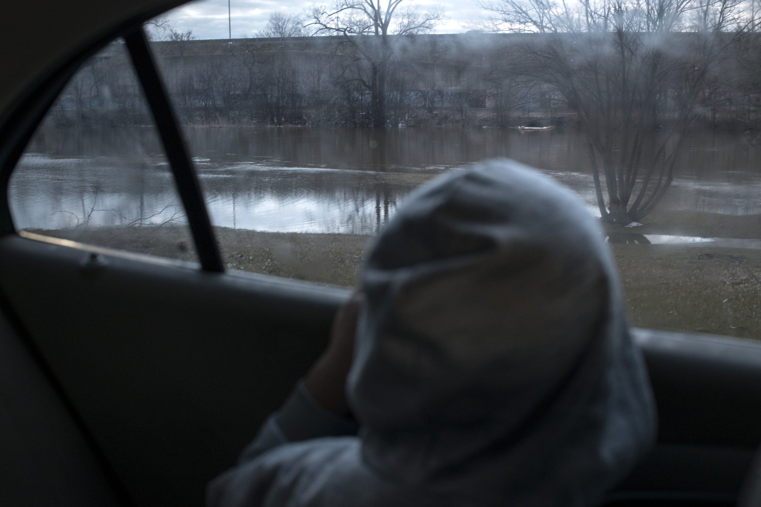 Sincere Smith, 5, gazes out of the window of his mother's car at the Flint river after noticing the water level had risen significantly following heavy rains on April 18, 2018. His mother, Ariana Hawk, previously remarked that the Flint river water, which was the city's water source at the start of the water crisis, still makes him nervous and he knows it as the water that gave him rashes.