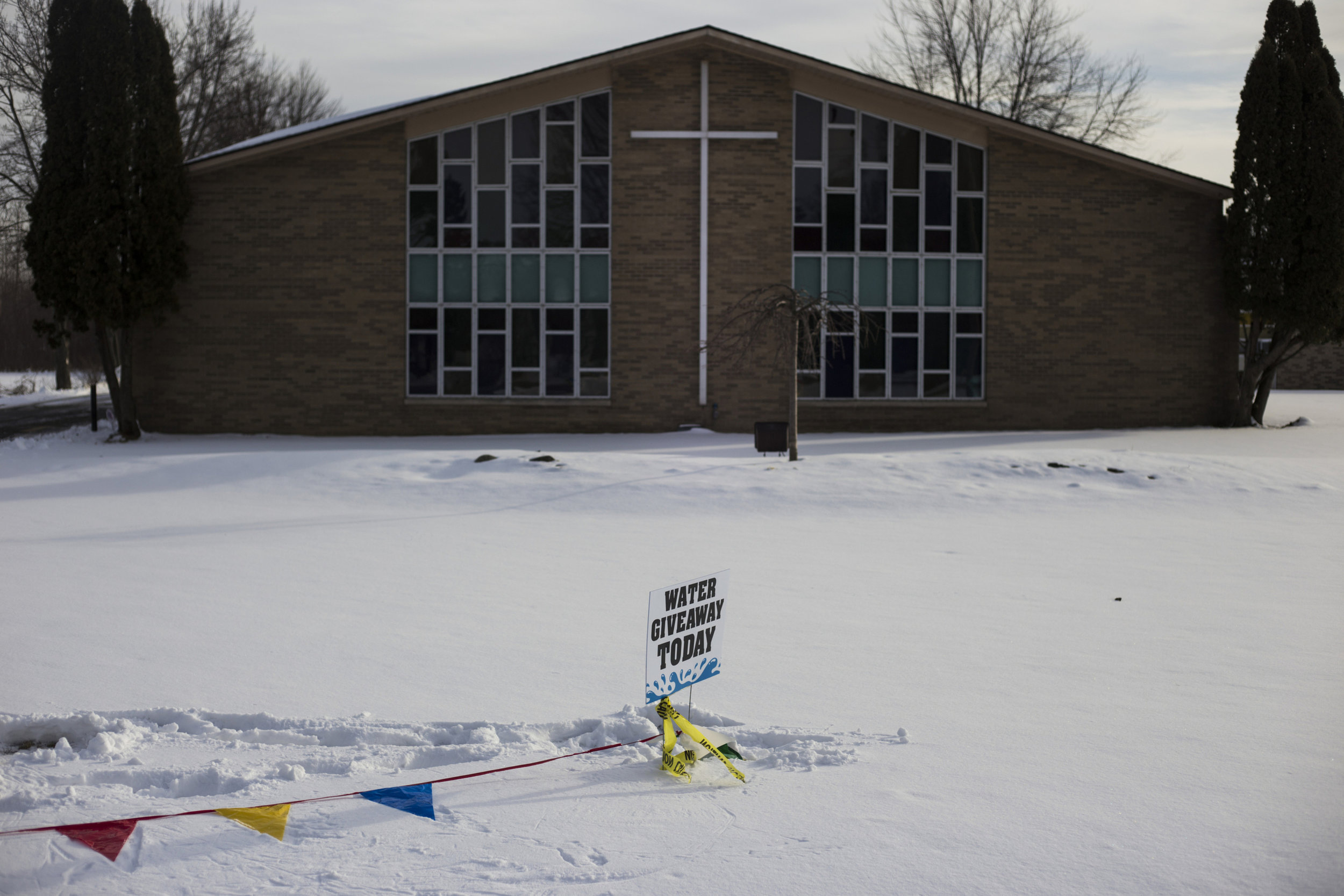 A water donation sign sits in the snow in front of the Jackson Memorial Temple Church in Flint, Mich., on February 18, 2016. Since the declaration for a state of emergency in the city in early January, many local churches took on the responsibility of distributing water to Flint residents.