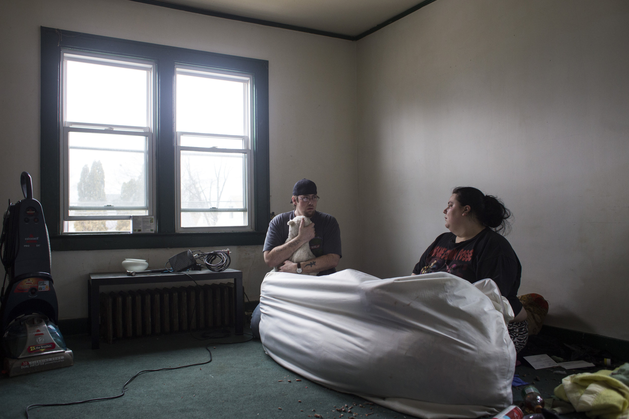 Jeff Sorensen, 33, clings on to a teddy bear while packing his studio apartment with his wife, Jess, as they prepare to move to Utah on February 26, 2016. The couple relocated due to the water crisis and lack of employment options in the city of Flint.
