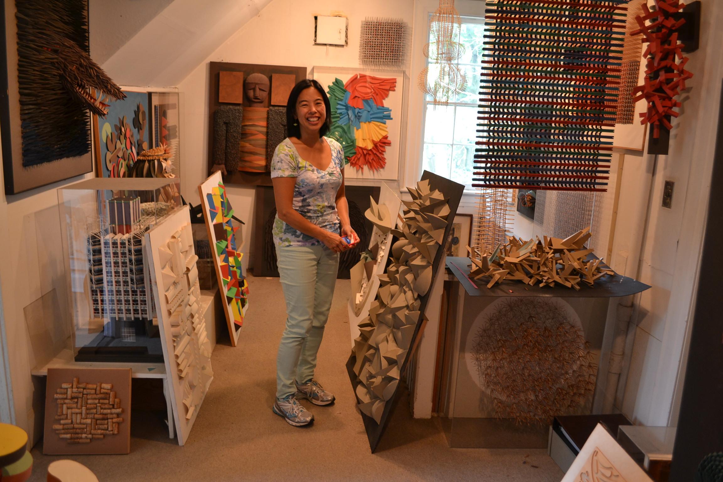 Jennifer Sandling surrounded by sculptures.JPG