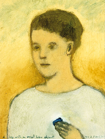 Boy with a small blue object