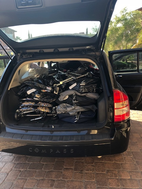 The car was stuffed with 4 rolling racks, several jewelry bags, and 10 garment bags worth of clothes