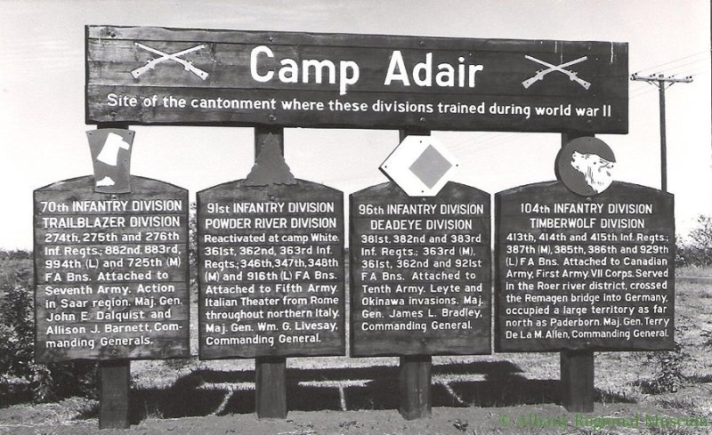 "Large signs reads, ""Camp Adair, site of the cantonment where these divisions trained during World War II."" They include the 70th, 91st, 96th, and 104th Infantry Divisions."