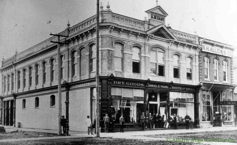 The S.E. Young and Son store at First and Broadalbin, c. 1895. This building was moved by a team of horses in 1925 to Second and Lyon, where it still stands today where it houses the Albany Regional Museum.