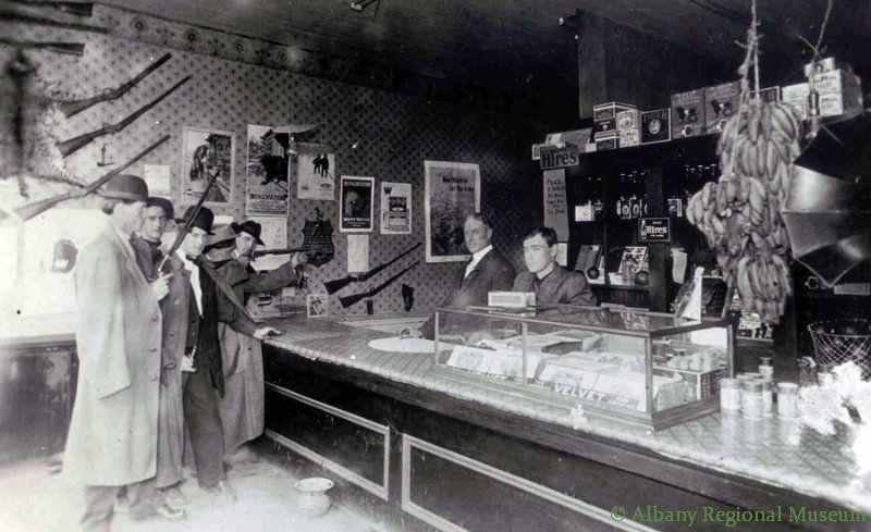 Interior of Clifford Walker's General Store and Shooting Gallery, 400 block of West First Avenue, c. 1914. Clifford later became a long time Albany florist: his father, Cyrus, was the first white, male child born west of the Mississippi.