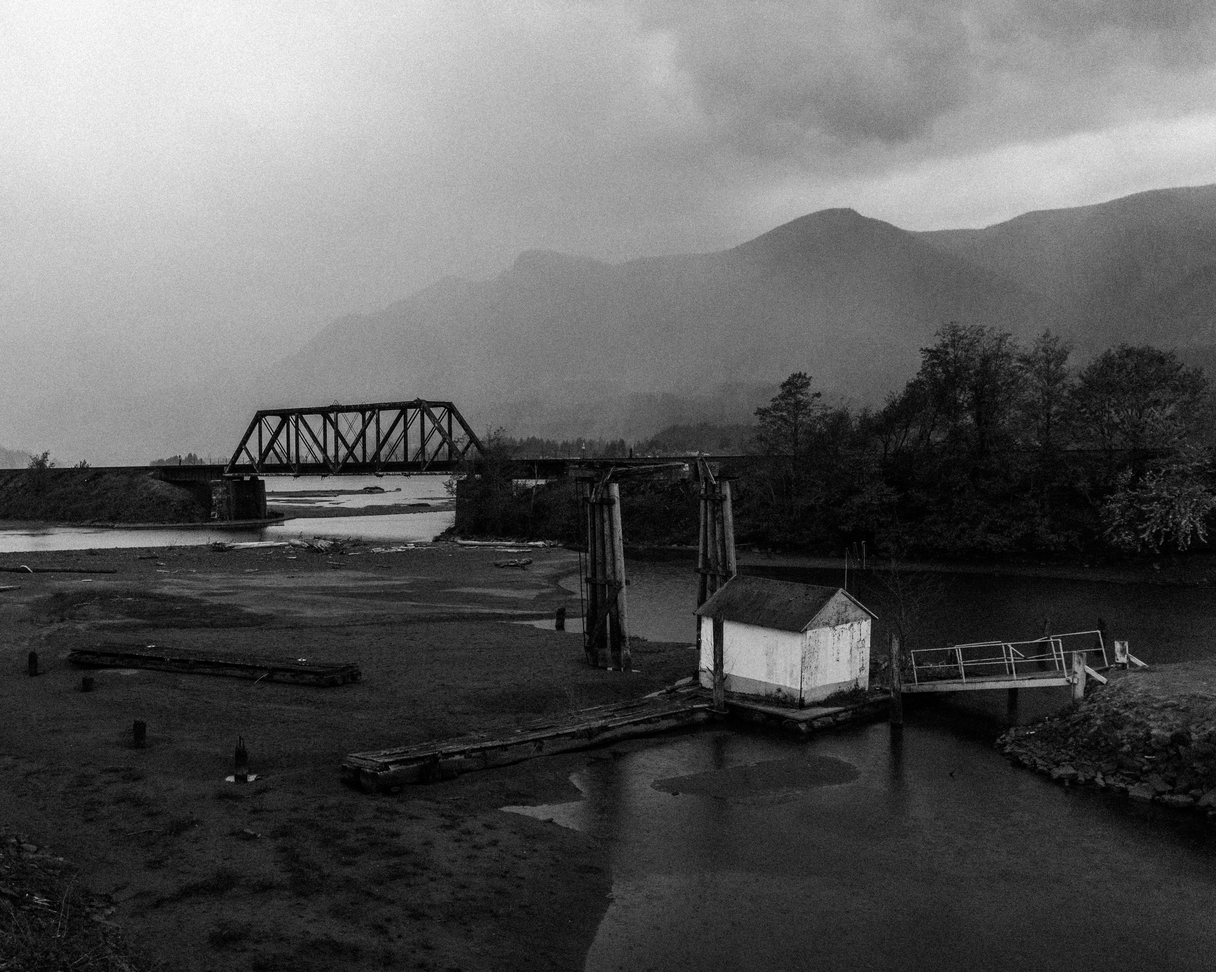 Boathouse and railroad bridge, April 2016