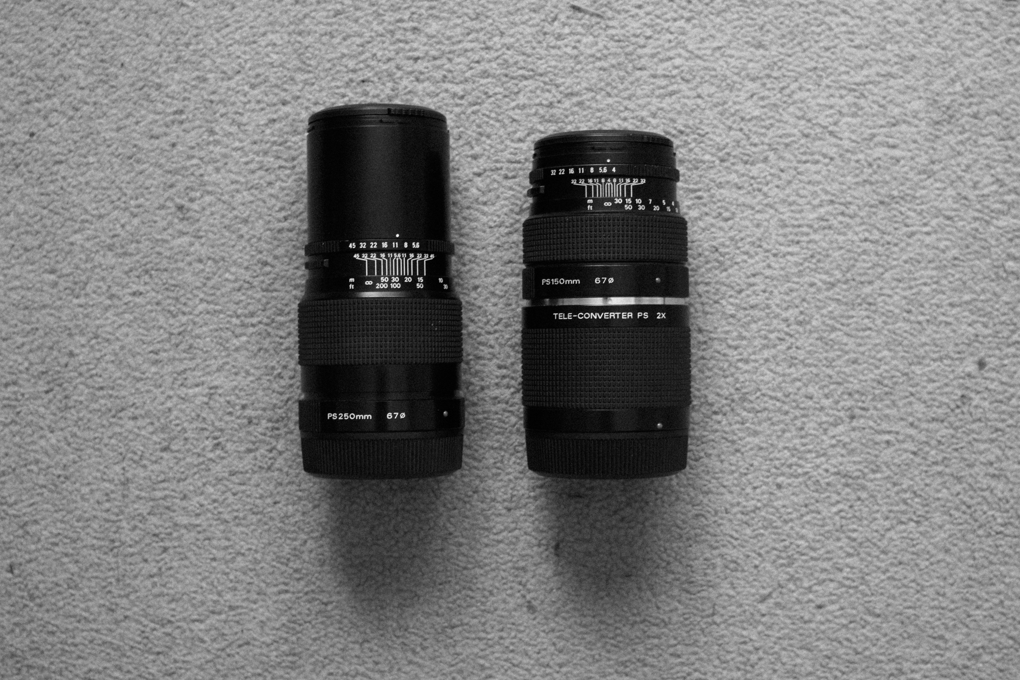 250mm vs 2x Teleconverter + 150mm f/4 lens: pretty much the same size