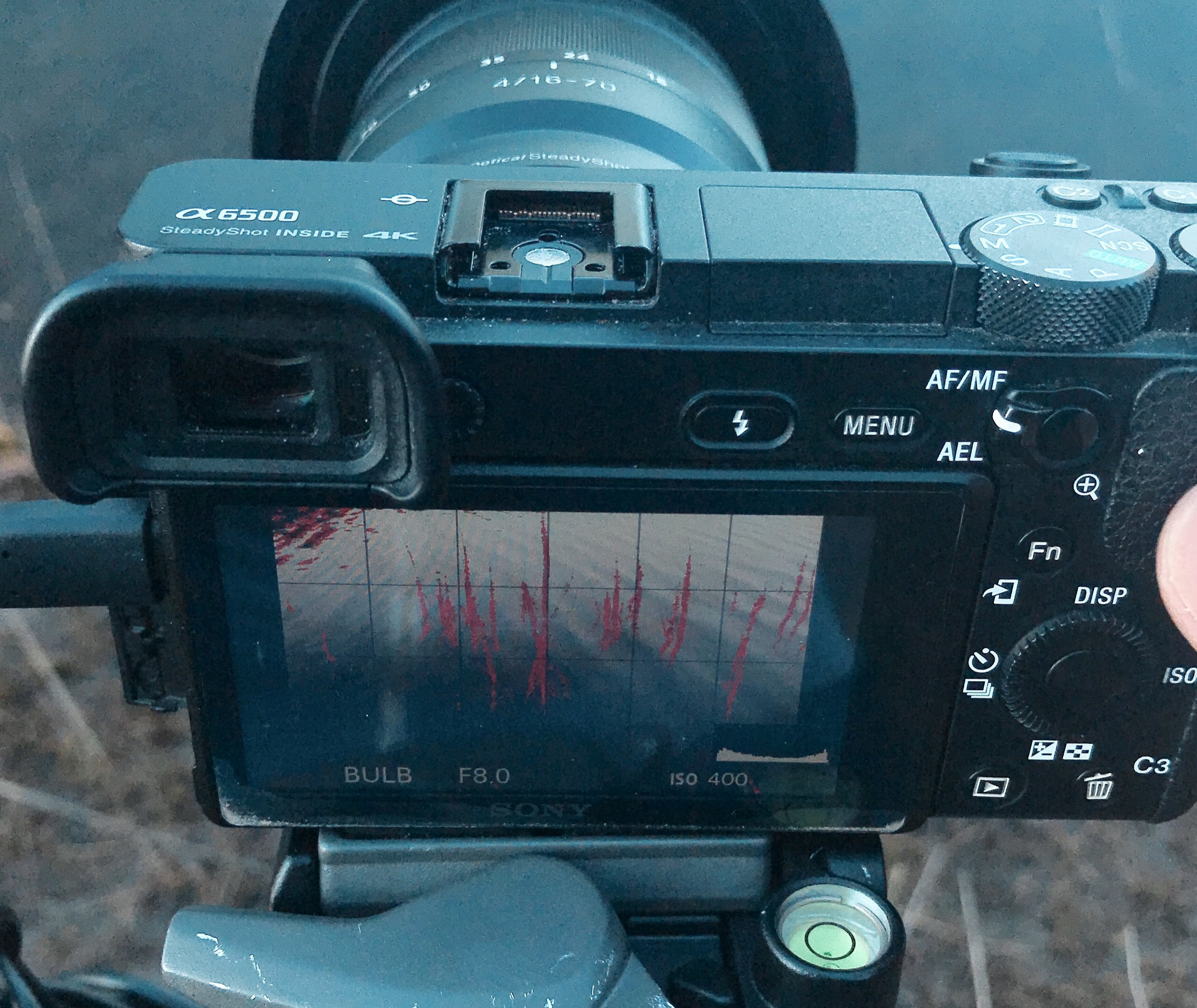 Switch to manual focus to prevent refocusing during the long exposure.