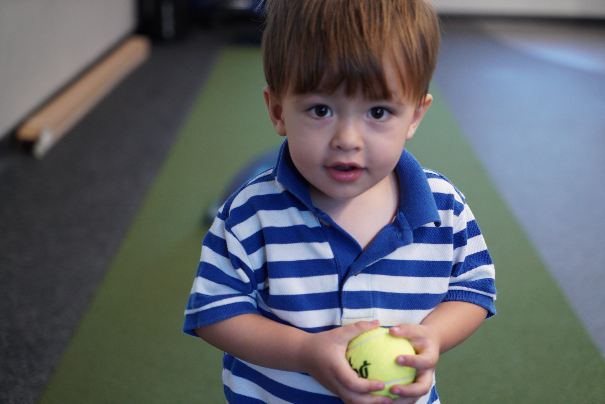 toddler with ball.jpg