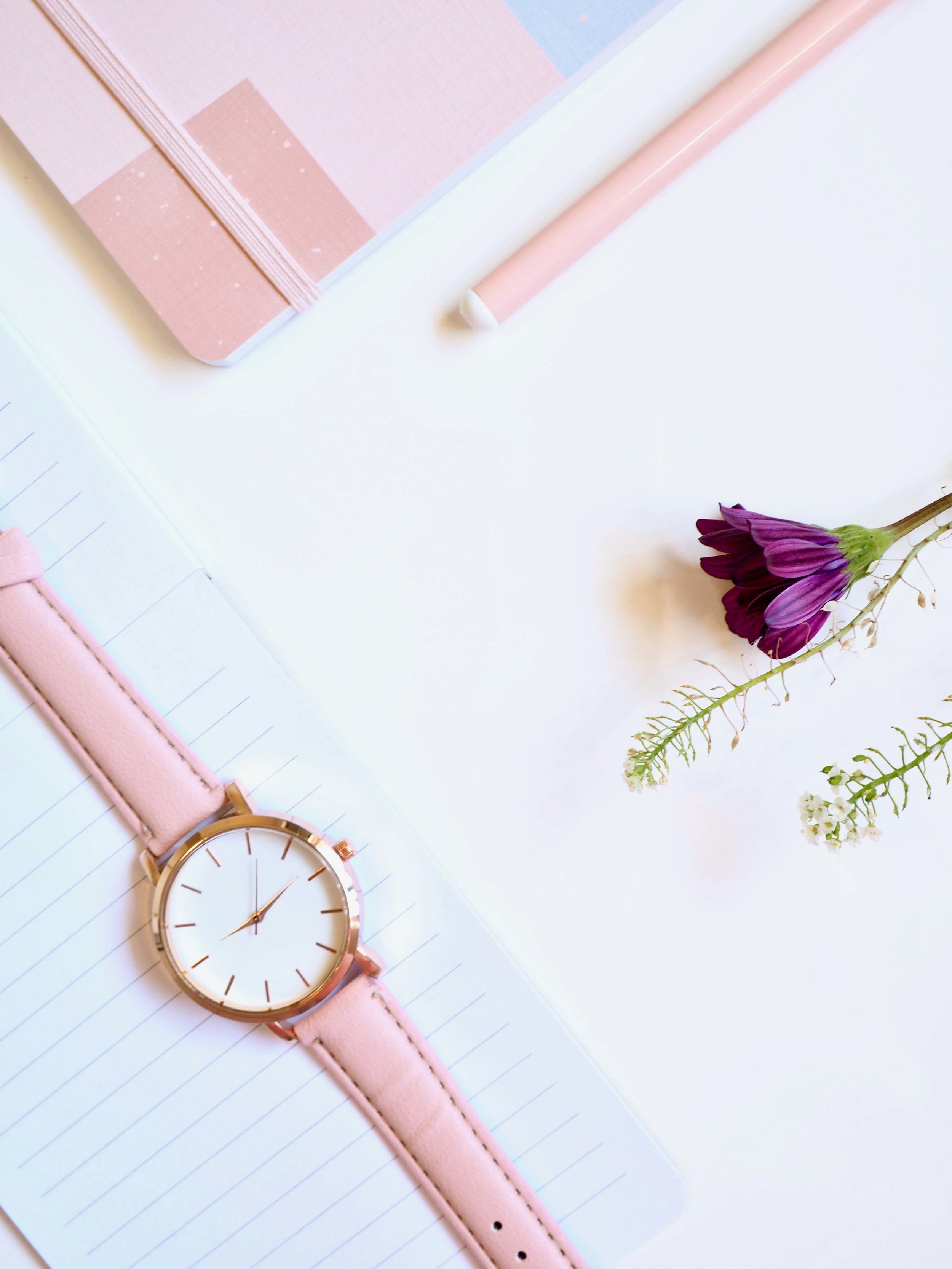 Watch and flowers in pink and purple.